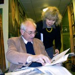 David Cleveland and Jane Alvey of the University of East Anglia. They are looking at a catalogue of an early Colchester pageant, a film about which is held in the East Anglian Film Archive.