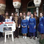 Volunteers in cinema uniform standing outside the Cinema Museum