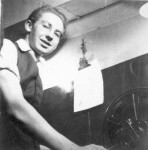 Portrait of a young Ronald Grant operating a projector