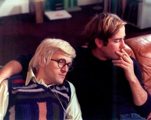 David Hockney rests his head on the shoulder of a young male friend