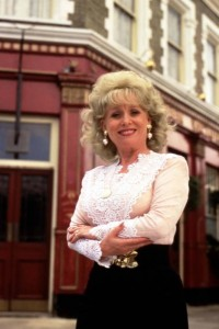 Promotional still for Eastenders with Barbara Windsor as Peggy Mitchell in front of the Queen Vic