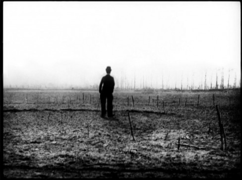 Silhouette of Charlie Chaplin in a barren field