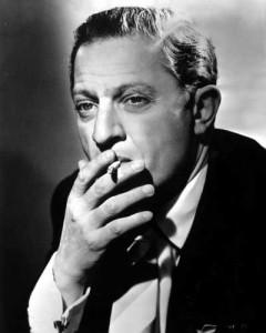 Portrait of Director Jules Dassin, smoking.